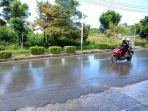 situasi-hujan-ringan-di-jalan-sedadap-24072021.jpg