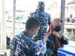 vaksinasi-masyarakat-maritim-di-kelurahan-mansapa-21092021.jpg