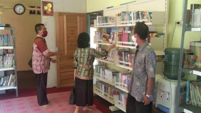 Disarpustaka Kapuas Lakukan Pembinaan di Perpustakaan Bajenta Desa Pulau Telo