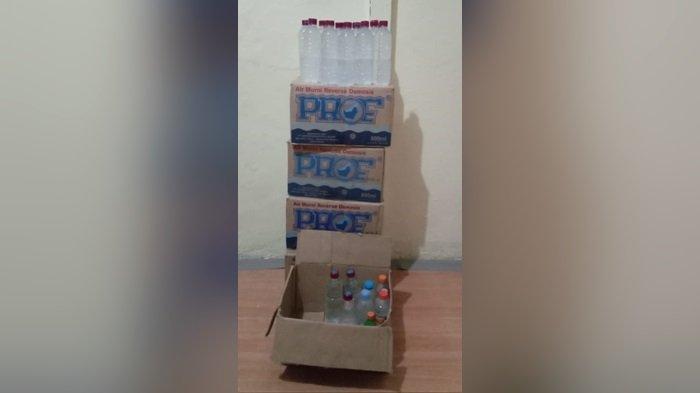 Polsek Kapuas Kuala Amankan 113 Botol Berisi Arak Putih, Pria Umur 34 Tahun Diamankan