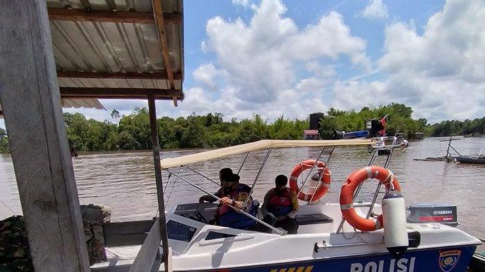Petugas Polresta Palangkaraya Pantau Debit Air Sungai Kahayan