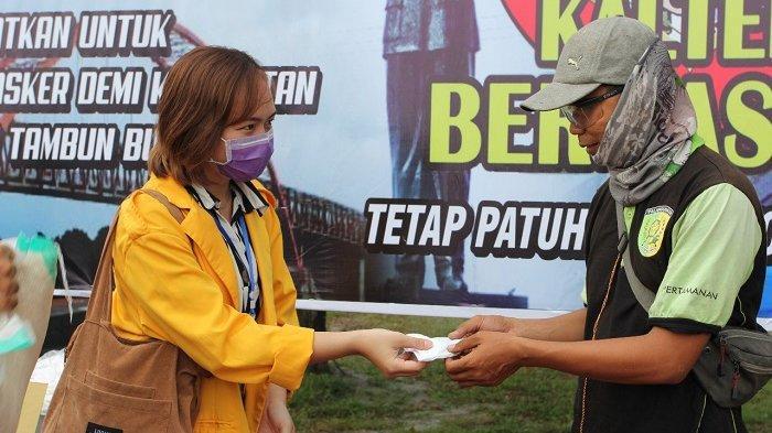 Bangun Zona Zero Covid-19, Polda Kalteng Bagi 1.000 Masker Gratis di Bundaran Besar Palangkaraya