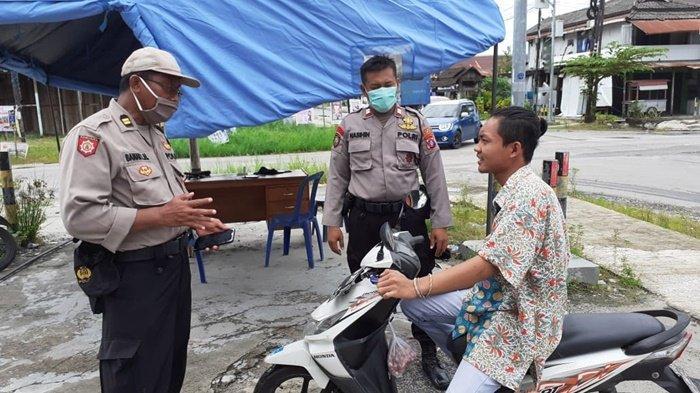 Cegah Penyebaran Covid-19, Polisi Palangkaraya Cegat Warga Tak Pakai Masker