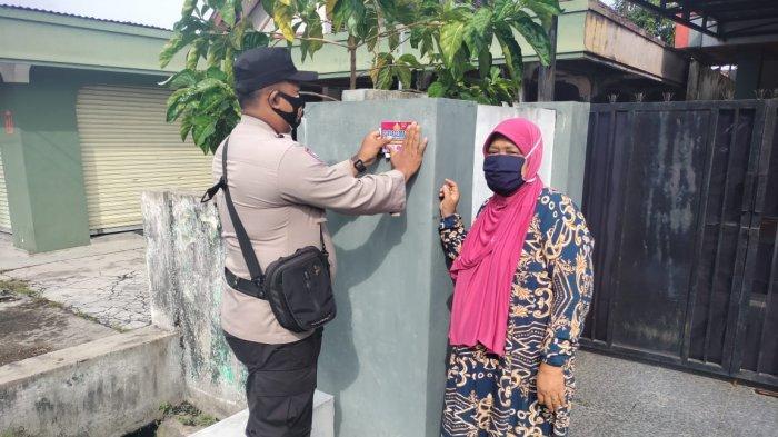 Petugas PPKM Palangkaraya Pantau Warga Terpapar Covid-19 Jalani Isolasi Mandiri di Rumah
