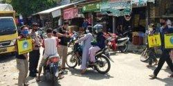 Relawan Covid-19 Imbau Pengunjung Pasar Besar Palangkaraya Pakai Masker