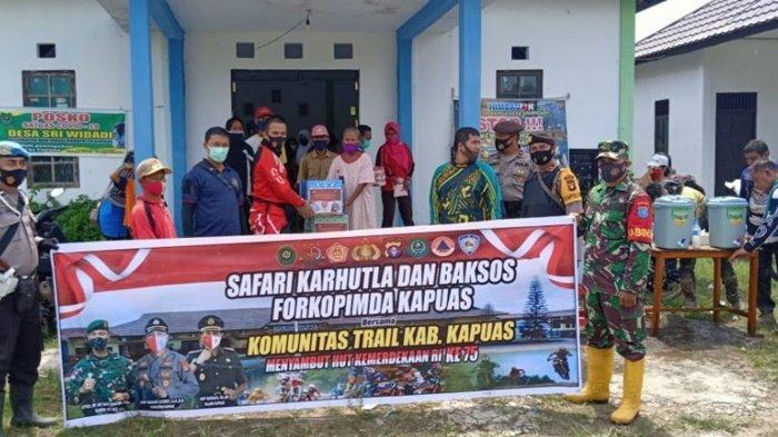 Kapolres Kapuas Naik Trail ke Pelosok Mentangai, Cegah Karhutla dan Bagikan Sembako
