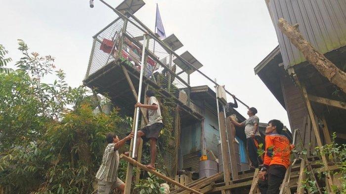Waspada Banjir, Alat Sistem Peringatan Dini Dipasang di Sei Pinang Kecamatan Mandau Talawang