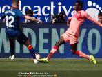 aksi-pemain-muda-barcelona-moussa-wague.jpg