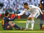 cristiano-ronaldo-of-real-madrid-helps-lionel-messi-of-barcelona.jpg