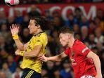 david-luiz-dan-scott-mctominay-manchester-united-vs-arsenal-liga-inggris.jpg