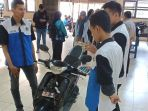 mahasiswa-poliban-banjarmasin-temukan-teknologi-aplikasi-pengaman-sepeda-motor_20180809_205922.jpg