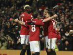 manchester-united-merayakan-gol-anthony-martial-ke-gawang-stoke-city_20180116_052233.jpg
