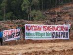 masyarakat-adat-berdemo-di-desa-kinipan-kalimantan-tengah-menolak-konvesi-hutan.jpg