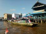 parade-di-sungai-katingan-dengan-mengibarkan-bendera-merah-putih_20180806_102158.jpg