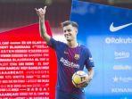 philippe-coutinho-saat-diperkenalkan-kepada-suporter-barcelona_20180109_052906.jpg
