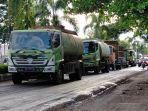 ratusan-truk-cpo-setiap-hari-hilir-mudik-melintas-jalan-umum-di-kota-sampit-kalteng.jpg