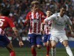 real-madrid-cristiano-ronaldo-berduel-dengan-striker-atletico-madrid-antonie-griezmann_20180409_062715.jpg