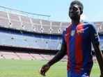 samuel-umtiti-diperkenalkan-sebagai-pemain-baru-barcelona_20180102_045909.jpg