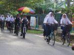 tribunkalteng-bersepeda-ke-sekolah-setelah-liburan_20180108_084248.jpg