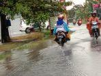 tribunkaltengcom-hujan-deras-di-palangkaraya.jpg