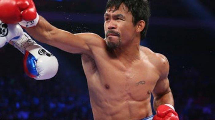 Manny Pacquiao saat tengah bertinju di atas ring,  simak jadwal Manny Pacquiao vs Errol Spence Jr