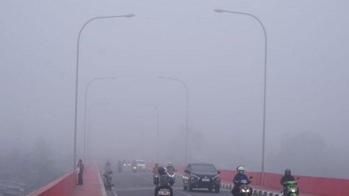 kabut-asap-tebal-menyelimuti-kota-palembang.jpg