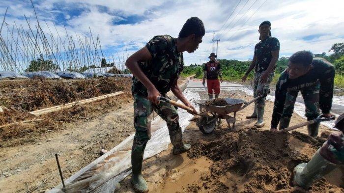 Semenisasi Jalan Licak Kampung Long Hubung Mahulu Dikerjakan Puluhan Satgas TMMD TNI AD
