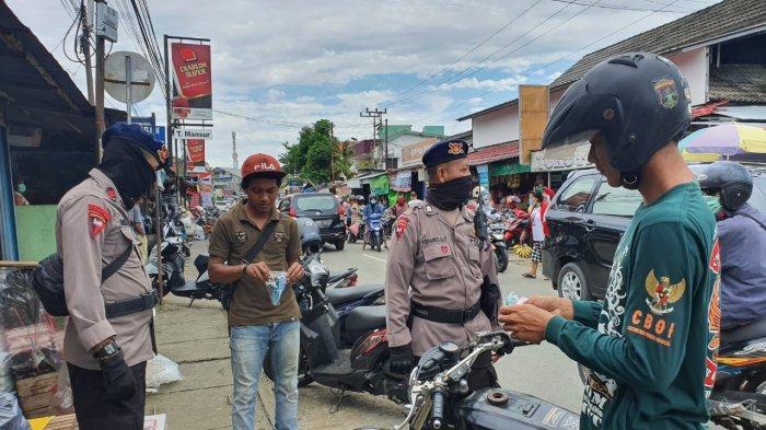 Brimob Polda Kaltim Kampanye Pakai Masker, Cegah Covid-19 Jelang Lebaran Idul Fitri di Balikpapan