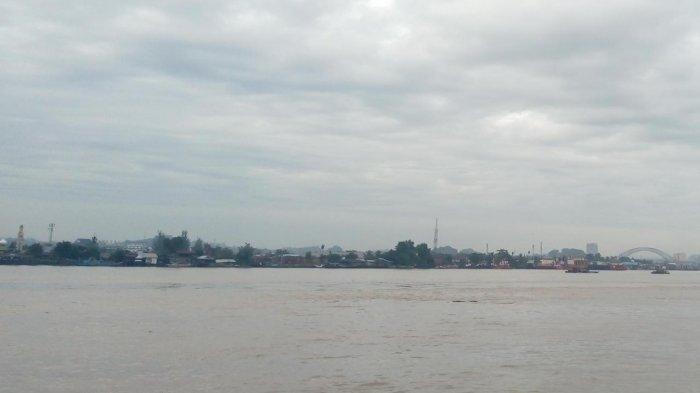 ILUSTRASI- Kondisi cuaca Samarinda hari ini, Minggu (23/5/2021) di daerah Sungai Mahakam Kota Samarinda, Kalimantan Timur, dalam kondisi berawan dengan potensi hujan ringan. TRIBUNKALTIM.CO/HANIFAN MA'RUF