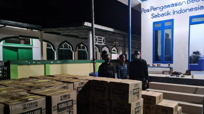 Satgas Pamtas Yonarhanud 16/SBC dan Bea Cukai Sebatik, Gagalkan Penyelundupan Minyak Pelumas Ilegal