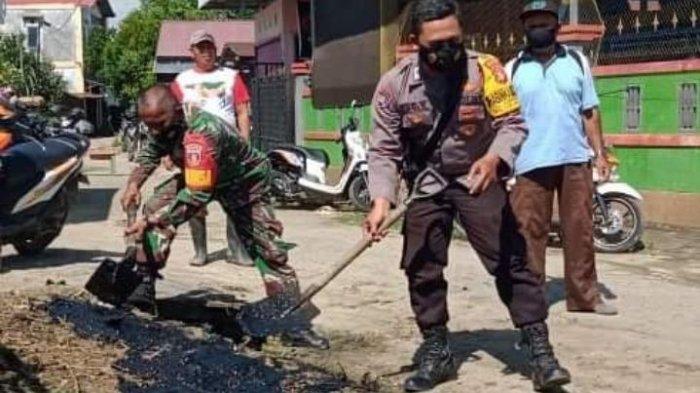 Unsur TNI-Polri, Kelurahan dan Warga Loa Janan Ilir Samarinda Gotong Royong Bersihkan Parit