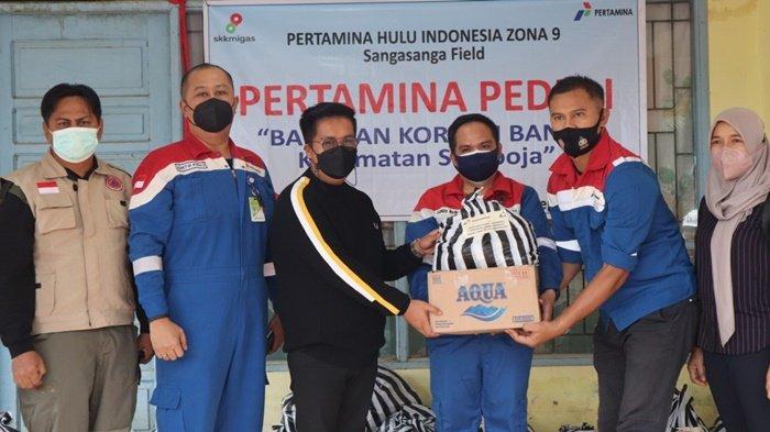 Wabup Terima dan Serahkan Bantuan Korban Banjir di Samboja