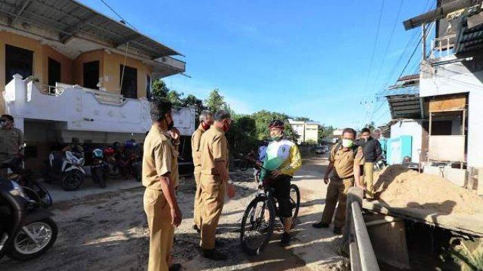 Sambil Gowes, Walikota Tarakan Khairul Tinjau Jalan dan Jembatan Rusak