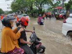 banjir-yang-merendam-jalan-raya-di-kawasan.jpg
