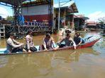 banjir-yang-sempat-merendam-kampung-mura-pahu-0.jpg
