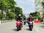 berkendara-menggunakan-sepeda-motor-honda.jpg