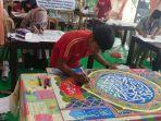 hasil-karya-mushaf-kaligrafi-milik-jusman-dalam-perlombaan-mtq-vi-tingkat-provinsi-kaltara.jpg