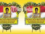 karangan-bunga-untuk-anggota-polda-sumatera-utara-aiptu-martua-sigalingging_20170627_091425.jpg