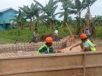 kegiatan-perekonomian-dan-pembangunan-masyarakat-di-desa-malinau-kota.jpg
