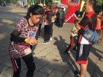 para-pelari-saat-memasuki-jalan-aspal-di-kegiatan-enggang-trail-run-minggu-27102019.jpg