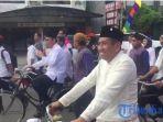 pasangan-rusmadi-safaruddin-naik-sepeda-ke-kantor-kpu_20180110_223736.jpg