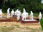 pemakaman-orang-meninggal-akibat-terpapar-virus-corona-di-tpu-covid-19-bontang-lestari.jpg
