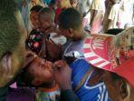 per-agustus-10205-anak-asmat-sudah-vaksin-campak-rubella-dan-polio-mrp_20180830_122218.jpg