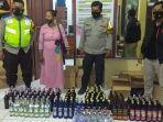 petugas-mengamankan-ibu-pemilik-warung-dan-menyita-ratusan-botol-miras-dari-berbagai-merk.jpg