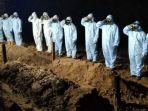 prosesi-pemakaman-jenazah-covid-19-di-pemakaman-serayu-minggu-1012021-tadi-malam.jpg