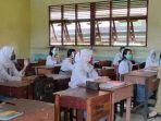 sekolah-dibuka-kembali-93929294.jpg