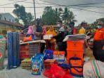 situasi-pemberian-bantuan-kepada-para-korban-kebakaran-di-kelurahan-gersik-kecamatan.jpg