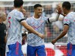 striker-manchester-united-portugal-cristiano-ronaldo-tengah-merayakan.jpg