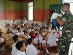 tapal-batas-personel-satgas-pamtas-ri-malaysia-yonif-raider-303ssm.jpg