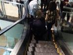 ujung-rok-tersangkut-eskalator_20170709_085919.jpg
